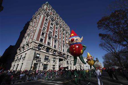 A Santa's Elf balloon floats down Central Park West during the 87th Macy's Thanksgiving Day Parade in New York November 28, 2013. REUTERS/Gary Hershorn