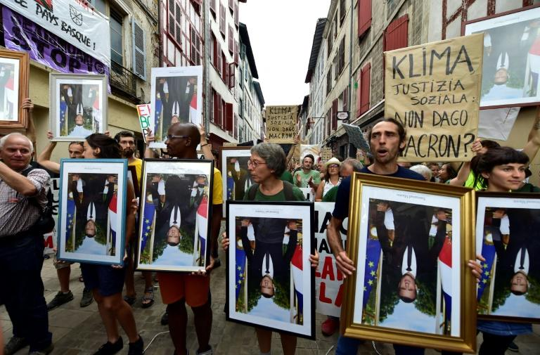 Protestors with upside-down official portraits of French President Emmanuel Macron, many seized from city halls across the country, during a G7 protest in Bayonne, southwest France, on Saturday (AFP Photo/ GEORGES GOBET)