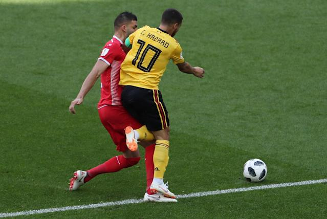 Moscow (Russian Federation), 23/06/2018.- Syam Ben Youssef (L) of Tunisia fouls Eden Hazard of Belgium during the FIFA World Cup 2018 group G preliminary round soccer match between Belgium and Tunisia in Moscow, Russia, 23 June 2018. (RESTRICTIONS APPLY: Editorial Use Only, not used in association with any commercial entity - Images must not be used in any form of alert service or push service of any kind including via mobile alert services, downloads to mobile devices or MMS messaging - Images must appear as still images and must not emulate match action video footage - No alteration is made to, and no text or image is superimposed over, any published image which: (a) intentionally obscures or removes a sponsor identification image; or (b) adds or overlays the commercial identification of any third party which is not officially associated with the FIFA World Cup) (Mundial de Fútbol, Bélgica, Moscú, Rusia, Túnez, Túnez) EFE/EPA/ABEDIN TAHERKENAREH EDITORIAL USE ONLY
