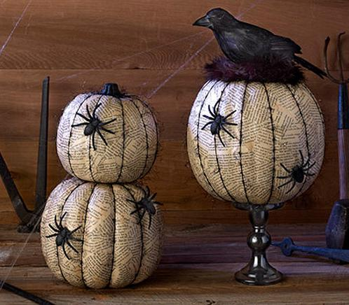 "<p>Try layering old newspaper on your pumpkin with <a href=""https://www.michaels.com/mod-podge-matte/M10047539.html"">Mod Podge</a>. Once it dries, line the ridges with a black Sharpie, and glue on some spooky plastic spiders. <i>(Photo: <a href=""http://dakotacreekchic.com/pumpkin-decorating-ideas-for-halloween/"">dakotacreekchic</a>)</i></p>"