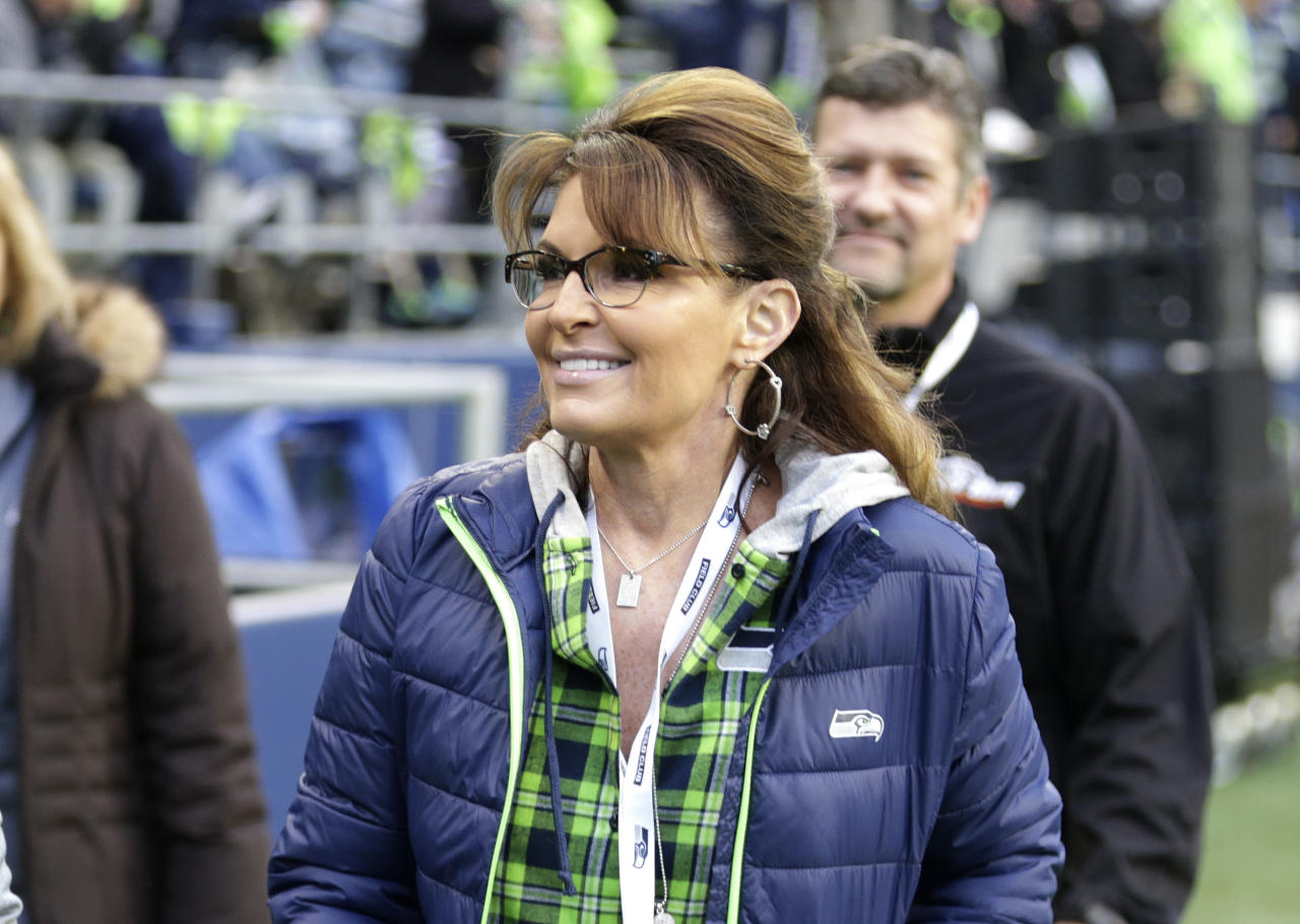 <p> FILE- In this Dec. 15, 2016, file photo, Sarah Palin, political commentator and former governor of Alaska, walks on the sideline before an NFL football game between the Seattle Seahawks and the Los Angeles Rams in Seattle. Palin is accusing The New York Times of defamation over an editorial that linked one of her political action committee ads to the mass shooting that severely wounded then-Arizona Congressman Gabby Giffords, according to a lawsuit filed in Manhattan federal court on Tuesday, June 27, 2017. (AP Photo/Scott Eklund, File) </p>