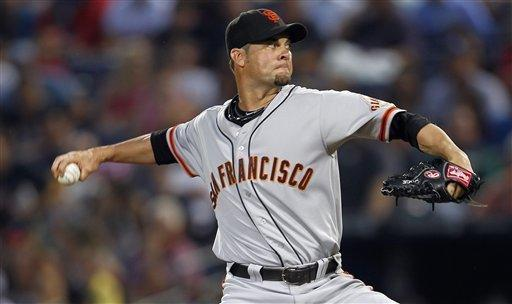 San Francisco Giants starting pitcher Ryan Vogelsong (32) works in the first inning of a baseball game against the Atlanta Braves, Wednesday, July 18, 2012, in Atlanta. (AP Photo/John Bazemore)