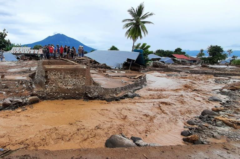 Torrents of mud washed over homes, bridges and roads in Indonesia's East Flores municipality