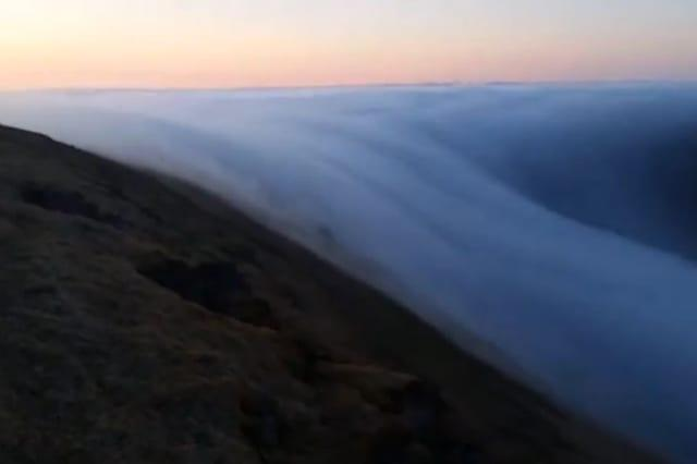'Fog river' seen rolling off a clifftop in Iceland (video)