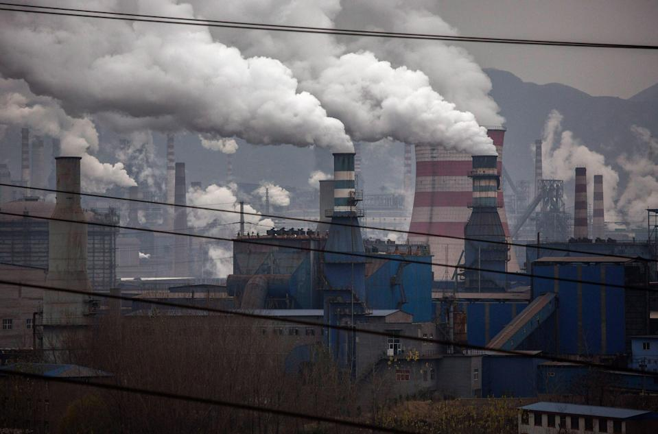 <p>Smoke billows from smokestacks and a coal fired generator at a steel factory in the industrial province of Hebei, China.</p> (Kevin Frayer/Getty Images)