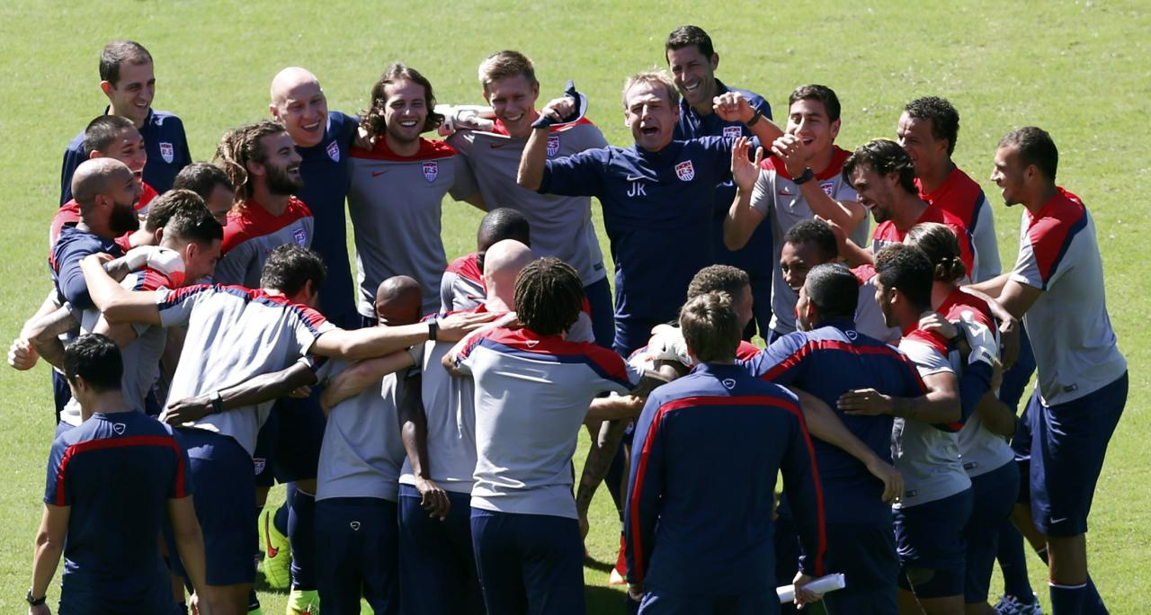 U.S. national soccer team coach Juergen Klinsmann (C) gestures as his team gathers during a training session ahead of their 2014 World Cup round of 16 match against Belgium in Salvador, June 30, 2014. REUTERS/Marcos Brindicci (BRAZIL - Tags: SOCCER SPORT WORLD CUP)