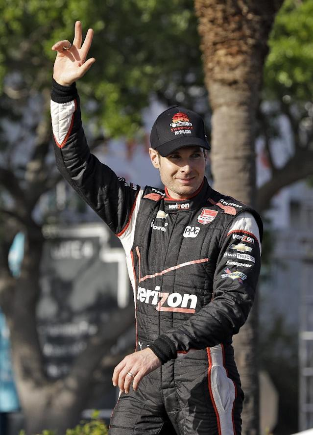Will Power, of Australia, waves to the crowd after winning the IndyCar Grand Prix of St. Petersburg auto race, Sunday, March 30, 2014, in St. Petersburg, Fla. (AP Photo/Chris O'Meara)