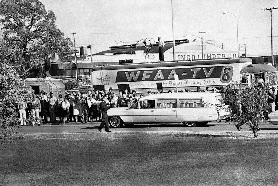 People are lining the street as the hearse bearing the body of slain U.S. President John F. Kennedy leaves Parkland Hospital in Dallas, Texas, to be flown to Washington on Nov. 22, 1963. (Photo:AP)