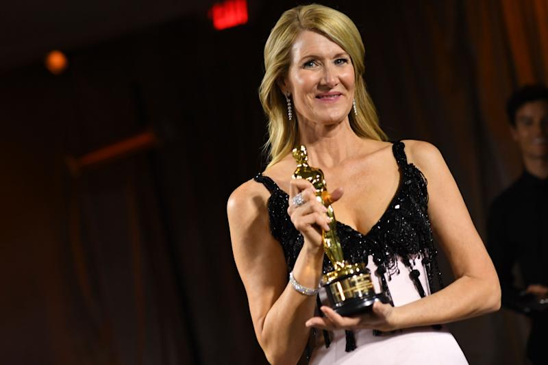 Laura Dern poses with her engraved award for Best Actress in a Supporting Role for Marriage Story.  (Photo: VALERIE MACON via Getty Images)