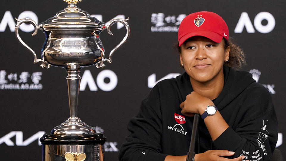 Naomi Osaka, pictured here next to the Daphne Akhurst Memorial Cup at her post-match press conference.