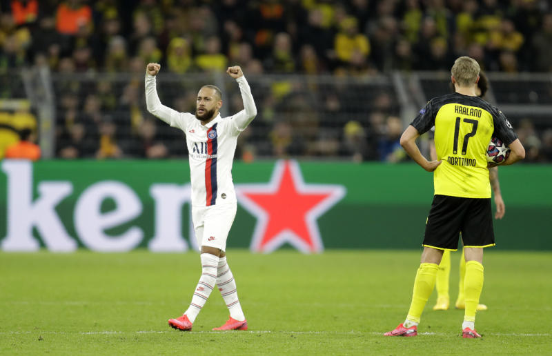 PSG's Neymar, left, celebrates after scoring his side's opening goal during the Champions League round of 16 first leg soccer match between Borussia Dortmund and Paris Saint Germain in Dortmund, Germany, Tuesday, Feb. 18, 2020. (AP Photo/Michael Probst)