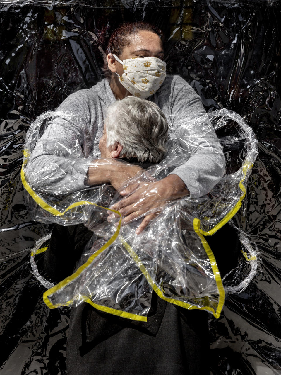 In this image released by World Press Photo, Thursday April 15, 2021, by Mads Nissen, Politiken, Panos Pictures, which won the World Press Photo of the Year award, and the first prize in the General News Singles category, titled The First Embrace, shows Rosa Luzia Lunardi (85) embraced by nurse Adriana Silva da Costa Souza, at Viva Bem care home, Sao Paulo, Brazil, on August 5, 2020. (Mads Nissen, Politiken, Panos Pictures, World Press Photo via AP)