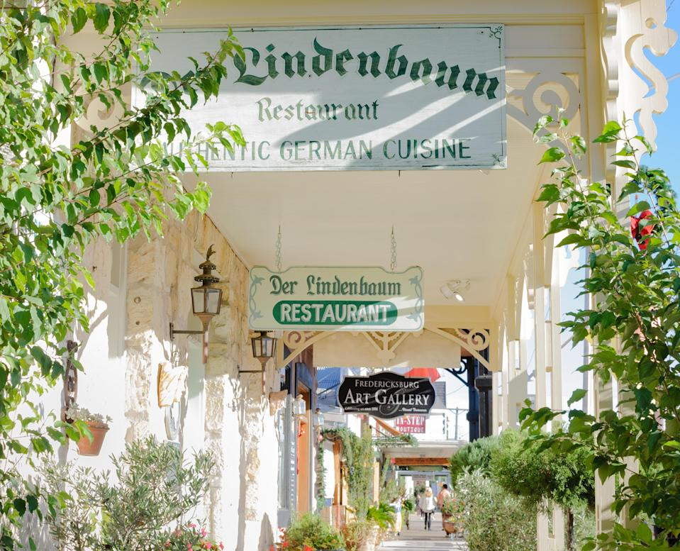 """With a proud German heritage, Fredericksburg is a Texan town with great historic sites and museums, but this is also the jumping off poiint for the Hill Country wine region, one of the most underrated places to enjoy a bottle in the country. Drive about four hours west of Houston (you can make a pit stop in <a href=""""https://www.cntraveler.com/destinations/austin?mbid=synd_yahoo_rss"""" rel=""""nofollow noopener"""" target=""""_blank"""" data-ylk=""""slk:Austin"""" class=""""link rapid-noclick-resp"""">Austin</a>) to reach this bucolic destination."""