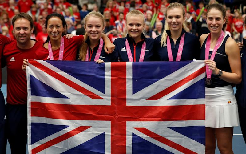 Great Britain captain Anne Keothavong, Great Britain's Katie Boulter, Katie Swan and Harriet Dart and Johanna Konta pose for a photo as they celebrate - Action Images via Reuters/Peter Cziborra