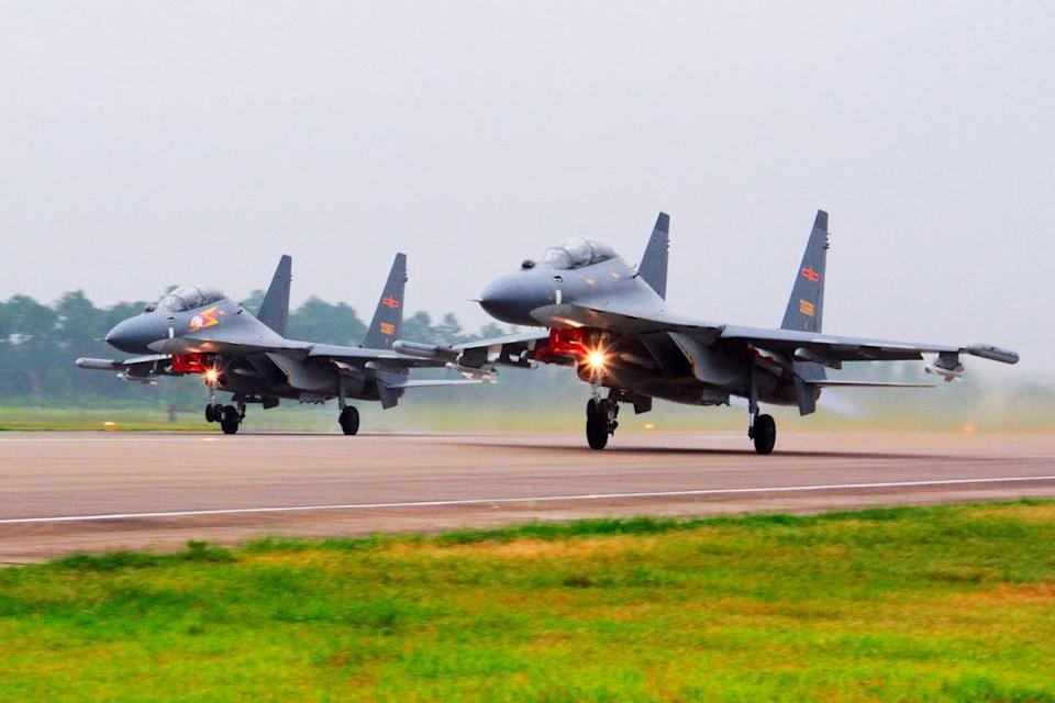 SU-30 fighter jets  take off from an unspecified location in China (AP)