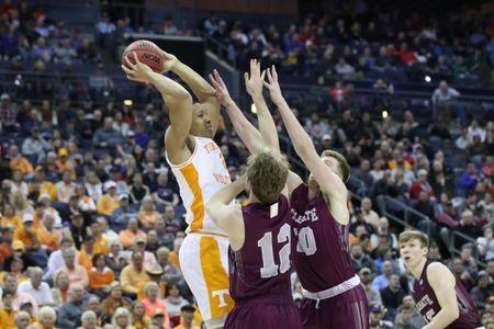 Mar 22, 2019; Columbus, OH, USA; Tennessee Volunteers forward Grant Williams (2) looks to move the ball defended by Colgate Raiders center Dana Batt (12) and forward Will Rayman (10) in the second half in the first round of the 2019 NCAA Tournament at Nationwide Arena. Mandatory Credit: Kevin Jairaj-USA TODAY Sports