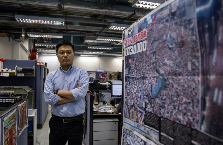 Apple Daily's chief editor Ryan Law says he is 'facing the greatest crisis' since he took the post three years ago