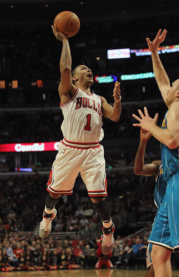 CHICAGO, IL - FEBRUARY 28: Derrick Rose #1 of the Chicago Bulls puts up a shot against Chris Kaman #35 of the New Orleans Hornets on his way to a game-high 32 points at the United Center on February 28, 2012 in Chicago, Illinois. The Bulls defeated the Hornets 99-95. NOTE TO USER: User expressly acknowledges and agrees that, by downloading and or using this photograph, User is consenting to the terms and conditions of the Getty Images License Agreement. (Photo by Jonathan Daniel/Getty Images)