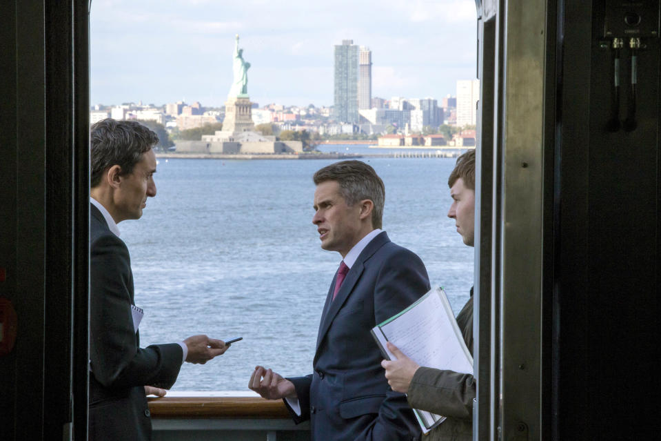 """FILE - In this Oct. 20, 2018, file photo, Britain's Defense Secretary Gavin Williamson speaks with members of the media during a visit to the HMS Queen Elizabeth, Britain's largest warship, near New York Harbor in New York. Williamson says the country plans to add two new overseas military bases in coming years, including one in Southeast Asia. Williamson told Britain's Sunday Telegraph newspaper in an interview published Dec. 30, 2018, that the other base would be in the Caribbean, part of what the paper called a push to """"step up (Britain's) military presence overseas after Brexit."""" (AP Photo/Eduardo Munoz Alvarez, File)"""
