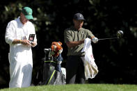 Tiger Woods, right, prepares to hit on the 11th hole with caddie Joe LaCava during the first round of the Masters golf tournament Thursday, Nov. 12, 2020, in Augusta, Ga. (Curtis Compton/Atlanta Journal-Constitution via AP)