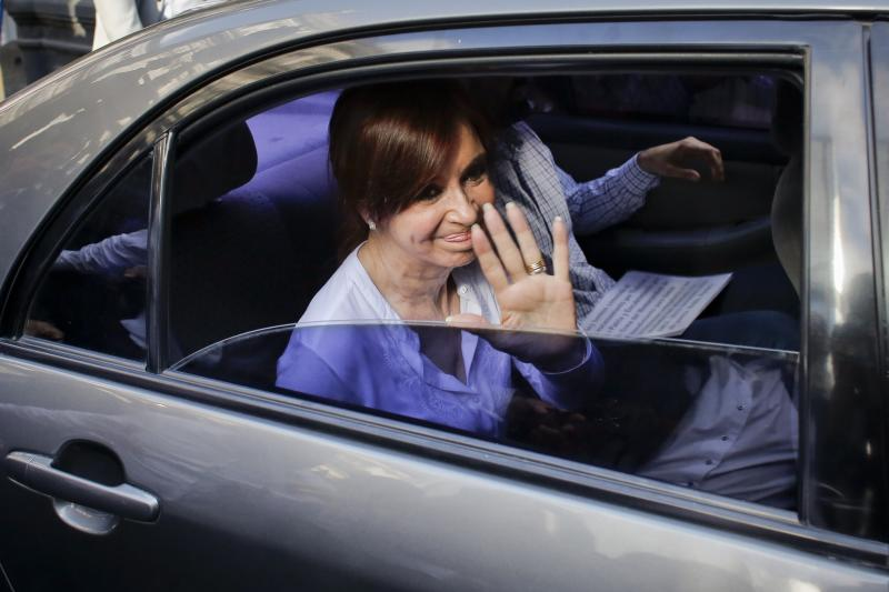 Argentina's former president, Sen. Cristina Fernandez waves to supporters as she leaves Congress, in Buenos Aires, Argentina, Thursday, Dec. 7, 2017. A federal judge on Thursday asked the Senate to allow the arrest of Fernandez on a charge of treason for allegedly covering up the role of Iranians in a 1994 bomb attack on a Jewish center. (AP Photo/Victor R. Caivano)