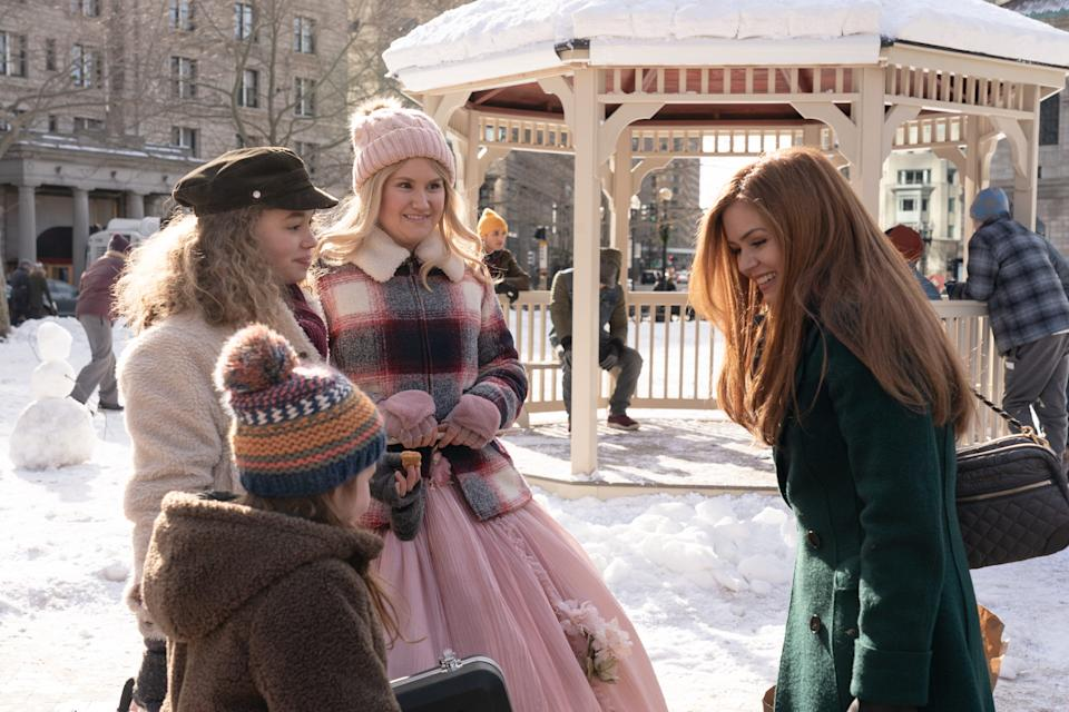 """Jillian Bell (center) is a fairy godmother who helps out a Boston mom (Isla Fisher) and her kids (Willa Skye and Jillian Shea Spaeder) in Disney+'s """"Godmothered."""""""