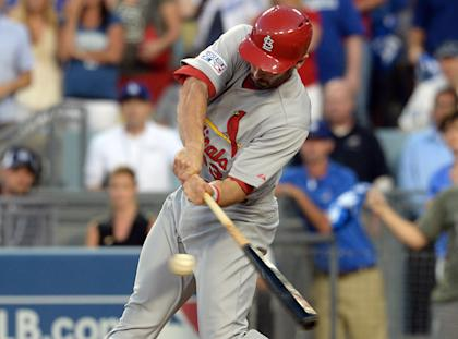 The Cardinals' Matt Carpenter prepares to connect on his three-run double. (USA TODAY Sports )