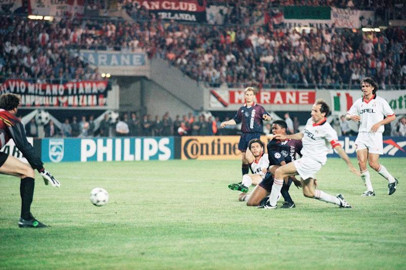 Patrick Kluivert scores the match-winning goal despite the efforts of Milan's Alessandro Costacurta and Franco Baresi