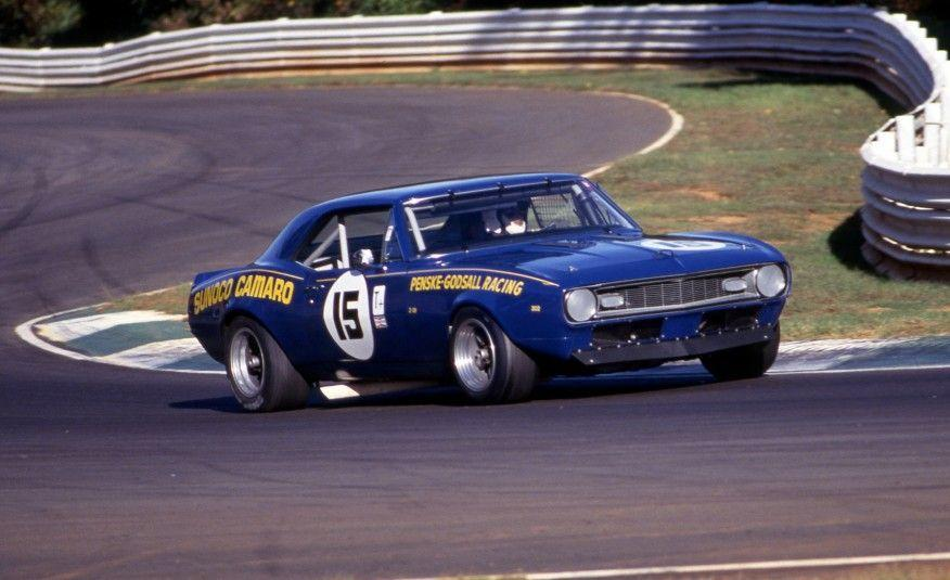 """<p>Chevrolet was determined to establish high-performance credentials for the Camaro. It did that with the creation of the 1967 Z/28 powered by the 290-hp DZ302 4.9-liter high-compression V-8. In the hands of team owner Roger Penske and driver Mark Donohue, the Z/28 would prove, after some creative engineering including an acid bath for the body shell, to be <a href=""""http://www.caranddriver.com/reviews/the-lightweight-camaro-1967-donohue-trans-am-camaro-archived-test-review"""" rel=""""nofollow noopener"""" target=""""_blank"""" data-ylk=""""slk:racing dynamite in the SCCA Trans-Am series"""" class=""""link rapid-noclick-resp"""">racing dynamite in the SCCA Trans-Am series</a>. During the 1967 season, Donohue would win three times. In 1968, the same car (redecorated as a '68) was among those used by Donohue to win 10 of the 13 races that season.</p>"""