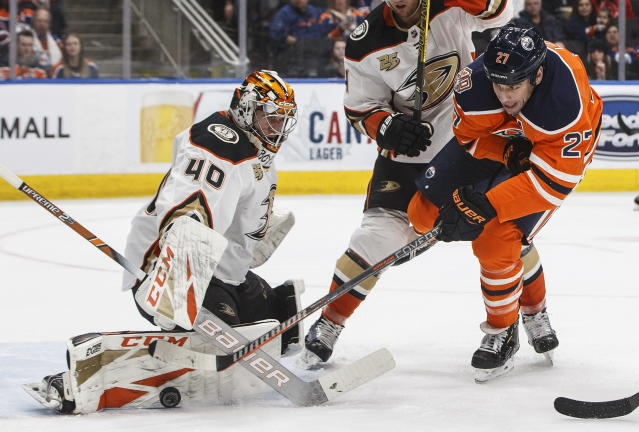 Anaheim Ducks' goalie Kevin Boyle (40) makes a save on Edmonton Oilers' Milan Lucic (27) during the second period of an NHL hockey game Saturday, Feb. 23, 2019, in Edmonton, Alberta. (Jason Franson/The Canadian Press via AP)