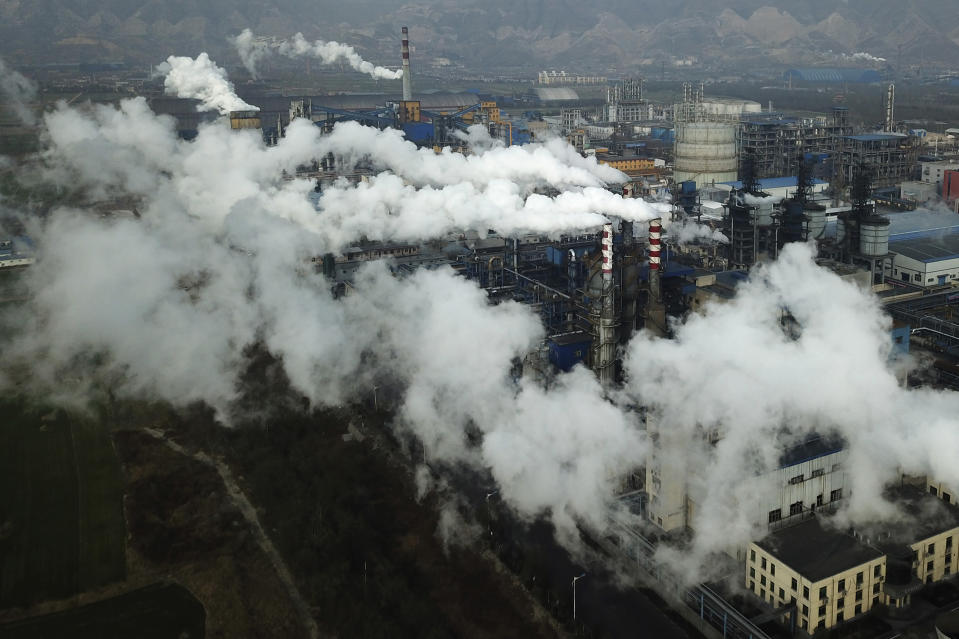 FILE - In this Nov. 28, 2019, file photo, smoke and steam rise from a coal processing plant in Hejin in central China's Shanxi Province. China's Premier Li Keqiang announced that the country would target a reduction of 18% in carbon intensity over the course of the next five years as part of the meeting of the ceremonial legislature which kicked off its annual meeting Friday, March 5, 2021. (AP Photo/Sam McNeil, File)