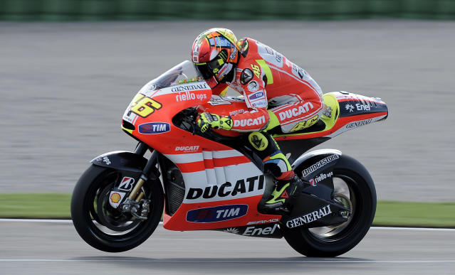 Ducati Team's Valentino Rossi of Italy rides his 1000cc motorcycle on November 8, 2011 during a Moto GP practice session at the Ricardo Tormo racetrack in Cheste, near Valencia. AFP PHOTO / JOSE JORDAN (Photo credit should read JOSE JORDAN/AFP/Getty Images)