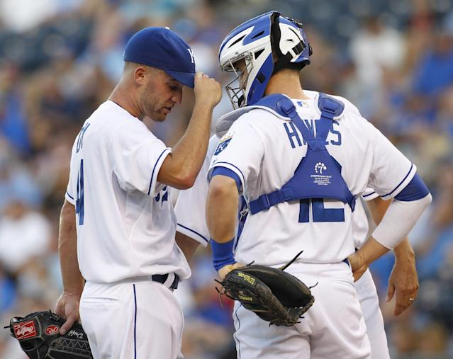 Kansas City Royals pitcher Danny Duffy, left, talks with catcher Brett Hayes in the first inning of a baseball game against the Minnesota Twins at Kauffman Stadium in Kansas City, Mo., Wednesday, Aug. 7, 2013. (AP Photo/Colin E. Braley)