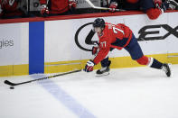 Washington Capitals right wing T.J. Oshie reaches for the puck during the second period of the team's NHL hockey game against the Philadelphia Flyers, Saturday, May 8, 2021, in Washington. (AP Photo/Nick Wass)