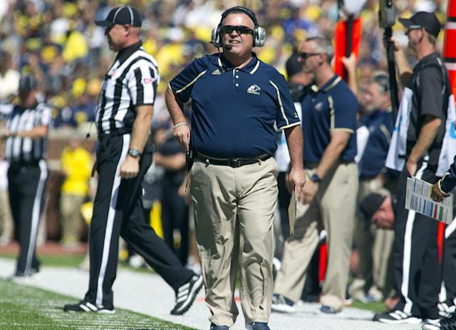 CORRECTS ID TO ASSISTANT COACH ALAN ARRINGTON, NOT HEAD COACH TERRY BOWDEN - Akron assistant coach Alan Arrington watches from the sideline during the second quarter of an NCAA college football game with Michigan, Saturday, Sept. 14, 2013, in Ann Arbor, Mich. (AP Photo/Tony Ding)