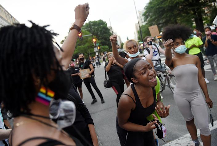 A woman cries as she protests the killing of George Floyd near the White House on June 3, 2020 in Washington, DC. (Olivier Douliery/AFP via Getty Images)