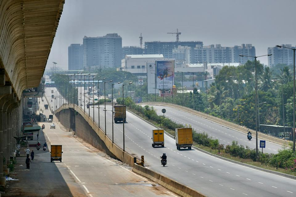 A partially deserted national highway is pictured during the weekend lockdown imposed as a preventive measure against the spread of the Covid-19 coronavirus in Bangalore on April 24, 2021. (Photo by Manjunath Kiran / AFP) (Photo by MANJUNATH KIRAN/AFP via Getty Images)