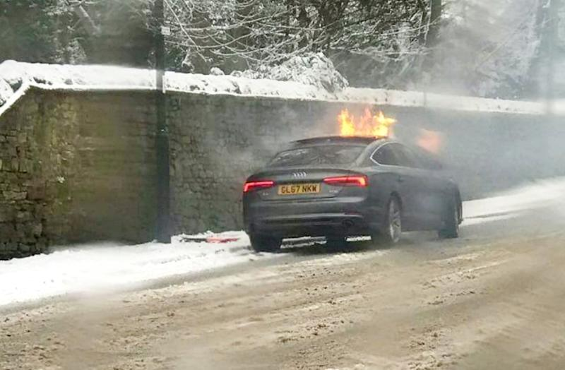 As he battled to put out the flames on his chest, Will watched in horror as the Audi A5 went up in flames (Picture: SWNS)