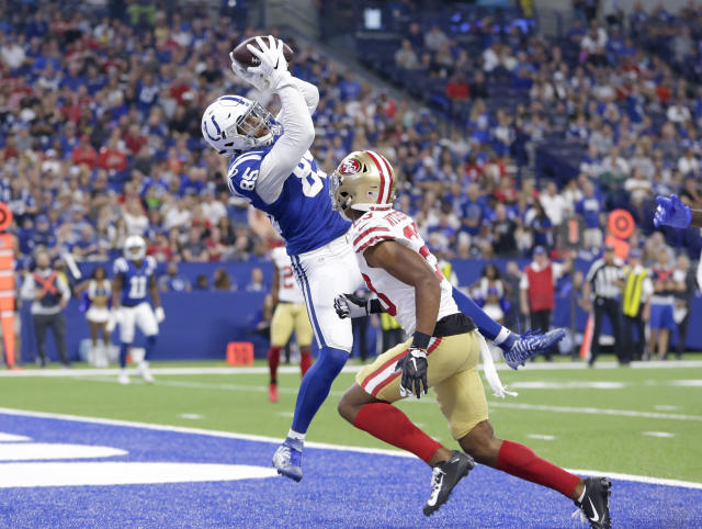 Indianapolis Colts tight end Eric Ebron (85) makes a catch in the end zone over San Francisco 49ers cornerback Ahkello Witherspoon (23) for a touchdown in the first half of an NFL preseason football game in Indianapolis, Saturday, Aug. 25, 2018. (AP Photo/AJ Mast)