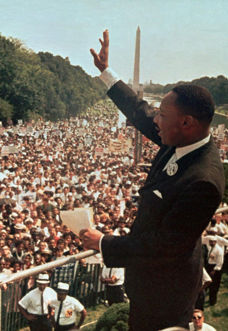 Dr. Martin Luther King Jr. acknowledges the crowd at the Lincoln Memorial, where he gave his