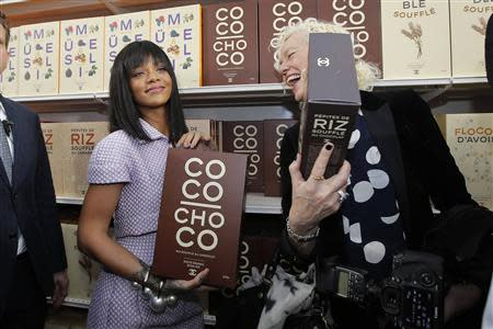 Singer Rihanna (L) poses with photographer Ellen von Unwerth after the German designer Karl Lagerfeld Fall/Winter 2014-2015 women's ready-to-wear collection show for French fashion house Chanel during Paris Fashion Week March 4, 2014. REUTERS/Stephane Mahe
