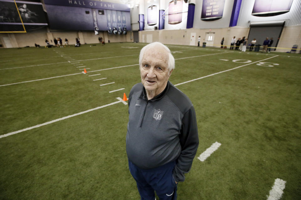 Gil Brandt poses for a photo in the indoor practice facility during TCU NFL football Pro Day Friday, March 27, 2015, in Fort Worth, Texas. (AP Photo/Tony Gutierrez)
