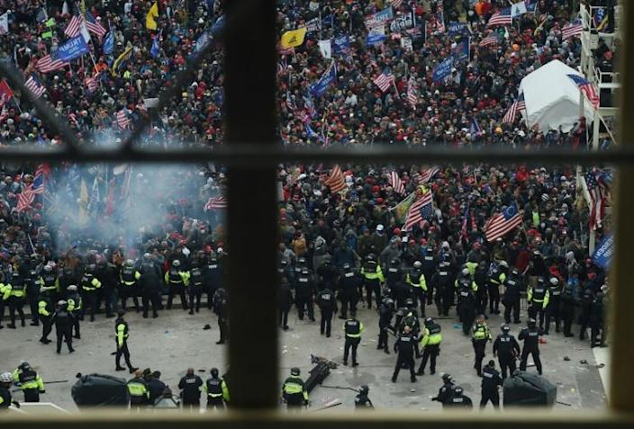 Police hold back supporters of US President Donald Trump as they gather outside the US Capitol before breaking through police lines