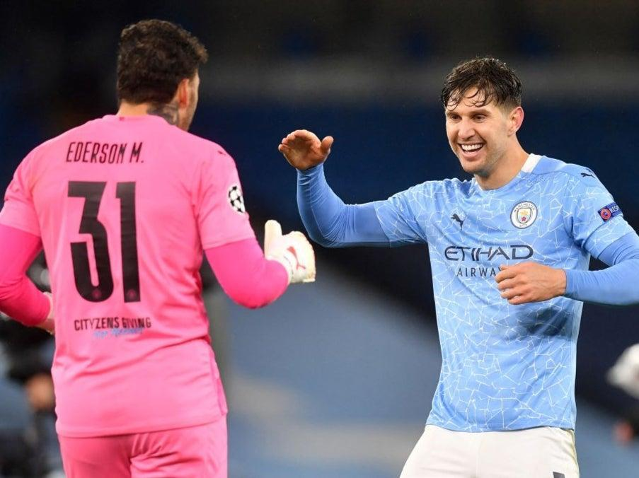 John Stones celebrates with goalkeeper EdersonAFP via Getty Images