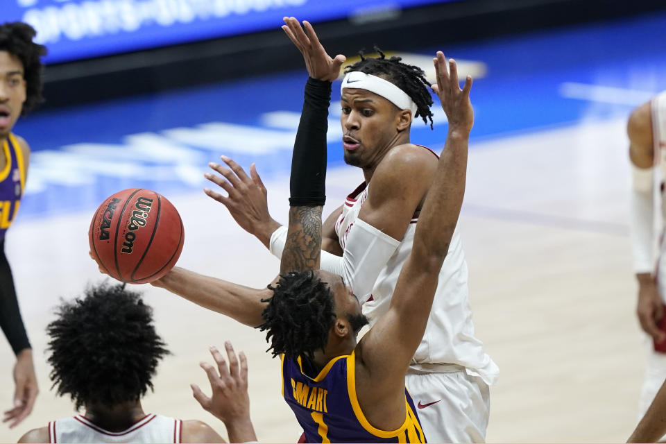 Arkansas' Moses Moody, top, drives against LSU's Ja'Vonte Smart (1) in the second half of an NCAA college basketball game in the Southeastern Conference Tournament Saturday, March 13, 2021, in Nashville, Tenn. (AP Photo/Mark Humphrey)