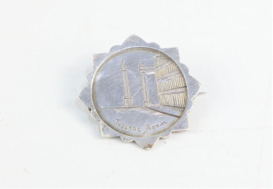 <p>This charming silver brooch dates back to 1886 and depicts the Theatre Royal, Newcastle, after it moved to Grey Street in 1837.</p>