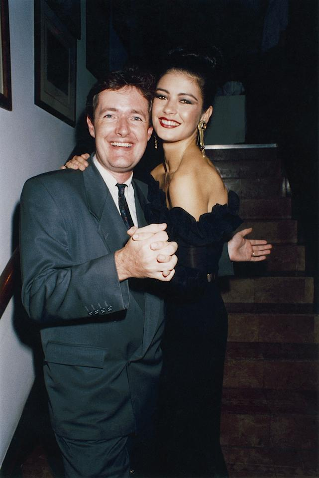 <p>Alongside Piers Morgan at the Spartacus launch party in London in 1992, Zeta-Jones wore a sleek top bun with an exaggerated smoky eye and red lip.</p>