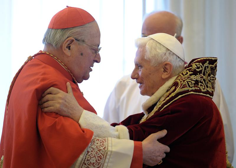 In this photo provided by the Vatican newspaper L'Osservatore Romano, Pope Benedict XVI, right, and Cardinal Angelo Sodano, Dean of the College of Cardinals, hug each other after the pontiff announced during the meeting of Vatican cardinals that he would resign on Feb. 28, at the Vatican, Monday, Feb. 11, 2013. Benedict XVI announced Monday that he would resign Feb. 28 - the first pontiff to do so in nearly 600 years. The decision sets the stage for a conclave to elect a new pope before the end of March. (AP Photo/L'Osservatore Romano, ho)