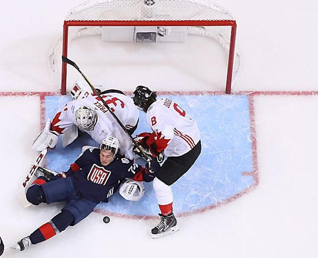 TORONTO, ON – SEPTEMBER 20: Carey Price #31 and Drew Doughty #8 of Team Canada defend their net against T.J. Oshie #74 of Team USA during the World Cup of Hockey game at Air Canada Centre on September 20, 2016 in Toronto, Ontario, Canada. (Photo by Andre Ringuette/World Cup of Hockey via Getty Images)
