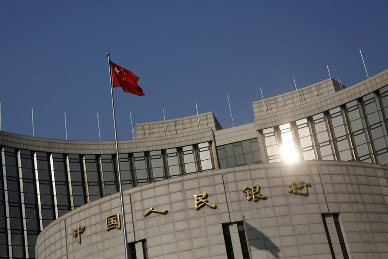 A Chinese national flag flies at the headquarters of the People's Bank of China, the country's central bank, in Beijing